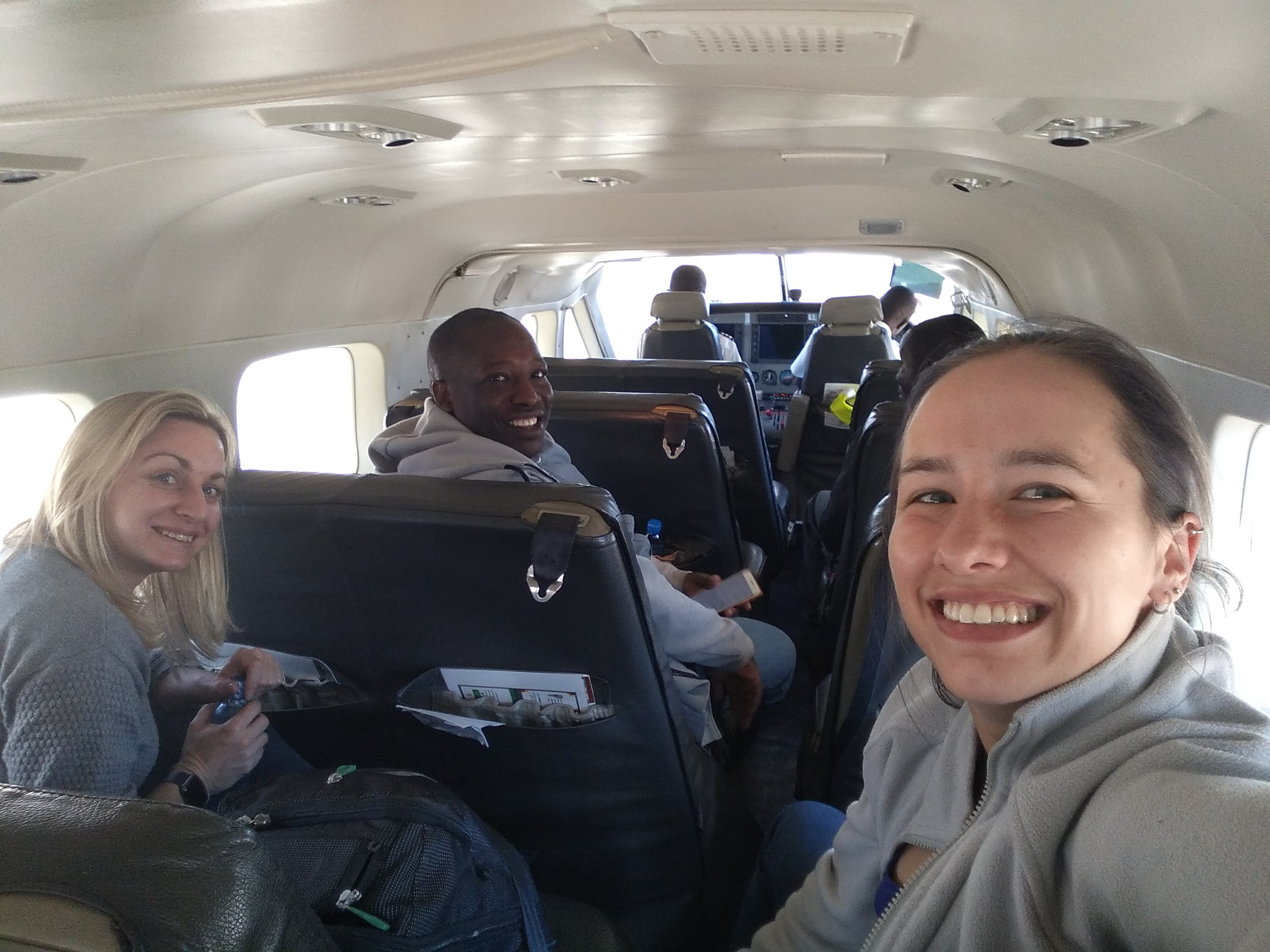 Kate Murray, Allen Makamure, Keethan Kander and Helen Hill on route to site via a charter plane in AFRICA
