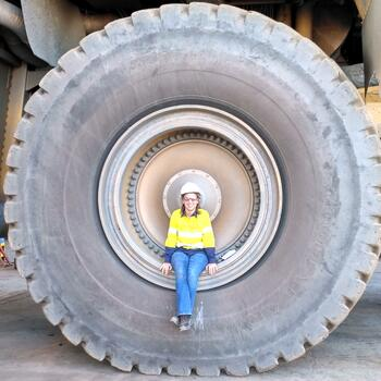 POSTED - 20170712 - Kate Murray showing how massive the tyres of a Komatsu 960E are in AFRICA - Edwina - PIP Juice (2)-1