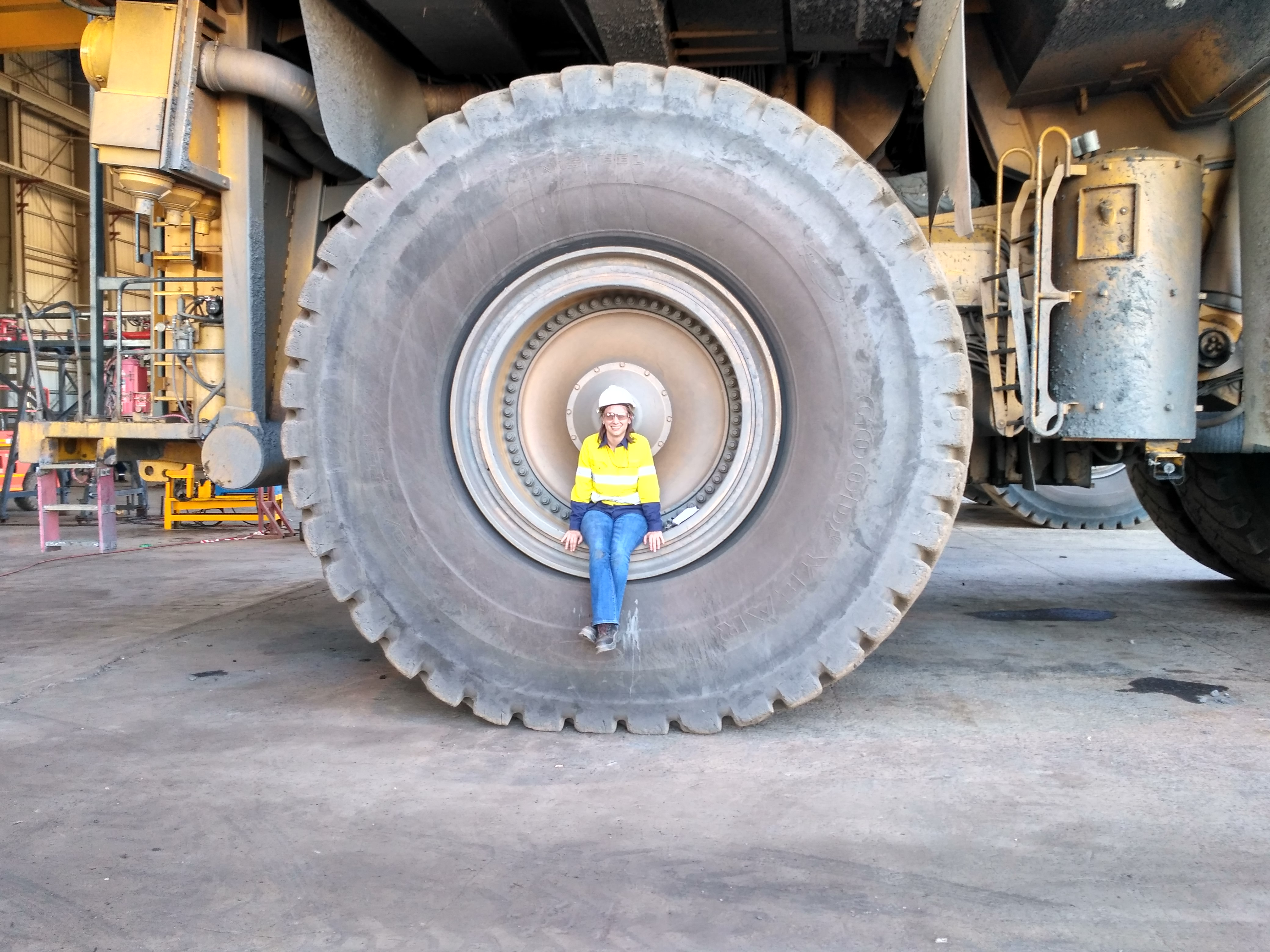POSTED - 20170712 - Kate Murray showing how massive the tyres of a Komatsu 960E are in AFRICA - Edwina - PIP Juice